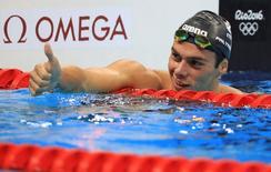 2016 Rio Olympics - Swimming - Final - Men's 1500m Freestyle Final - Olympic Aquatics Stadium - Rio de Janeiro, Brazil - 13/08/2016. Gregorio Paltrinieri (ITA) of Italy reacts after winning the gold.  REUTERS/Dominic Ebenbichler