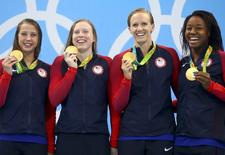 2016 Rio Olympics - Swimming - Victory Ceremony - Women's 4 x 100m Medley Relay Victory Ceremony - Olympic Aquatics Stadium - Rio de Janeiro, Brazil - 13/08/2016. Gold medallists Kathleen Baker (USA) of USA, Lilly King (USA) of USA, Dana Vollmer (USA) of USA and Simone Manuel (USA) of USA pose with their medals.   REUTERS/Dominic Ebenbichler