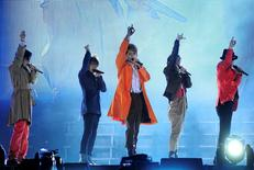 Members of Japanese pop music group SMAP (from L) Goro Inagaki, Takuya Kimura, Shingo Katori, Tsuyoshi Kusanagi, Masahiro Nakai perform during their concert in Beijing, September 16, 2011. REUTERS/China Daily