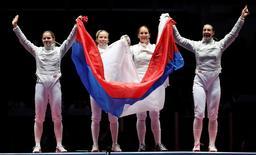 2016 Rio Olympics - Fencing - Final - Women's Sabre Team Gold Medal Match - Carioca Arena 3 - Rio de Janeiro, Brazil - 13/08/2016. Russia celebrates winning the match. REUTERS/Toru Hanai