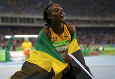 2016 Rio Olympics - Athletics - Final - Women's 100m Final - Olympic Stadium - Rio de Janeiro, Brazil - 13/08/2016. Elaine Thompson (JAM) of Jamaica celebrates winning.   REUTERS/Ivan Alvarado