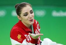 2016 Rio Olympics - Artistic Gymnastics - Final - Women's Uneven Bars Final - Rio Olympic Arena - Rio de Janeiro, Brazil - 14/08/2016. Aliya Mustafina (RUS) of Russia celebrates winning the gold. REUTERS/Ruben Sprich