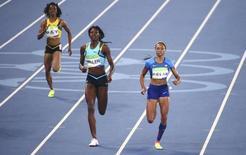 2016 Rio Olympics - Athletics - Semifinal - Women's 400m Semifinals - Olympic Stadium - Rio de Janeiro, Brazil - 14/08/2016. Christine Day (JAM) of Jamaica, Shaunae Miller (BAH) of Bahamas and Allyson Felix (USA) of USA compete. REUTERS/David Gray