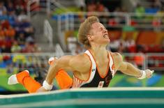 2016 Rio Olympics - Artistic Gymnastics - Final - Men's Horizontal Bar Final - Rio Olympic Arena - Rio de Janeiro, Brazil - 16/08/2016. Epke Zonderland (NED) of Netherlands falls. REUTERS/Mike Blake