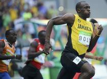 2016 Rio Olympics - Athletics - Preliminary - Men's 200m Round 1 - Olympic Stadium - Rio de Janeiro, Brazil - 16/08/2016. Usain Bolt (JAM) of Jamaica competes. REUTERS/Sergio Moraes