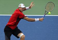 Aug 16, 2016; Mason, OH, USA; John Isner (USA) returns a shot against Fabio Fognini (ITA) on day four during the Western and Southern tennis tournament at Linder Family Tennis Center. Mandatory Credit: Aaron Doster-USA TODAY Sports