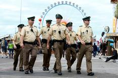 German police officers patrol the grounds of the 182nd Oktoberfest in Munich, Germany, September 19, 2015.     REUTERS/Michaela Rehle/File Photo