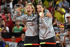 Aug 17, 2016; Rio de Janeiro, Brazil;  Laura Ludwig (GER) and Kira Walkenhorst (GER) celebrate winning the gold medal during the women's gold medal match in the Rio 2016 Summer Olympic Games at Beach Volleyball Arena. Mandatory Credit: Kyle Terada-USA TODAY Sports