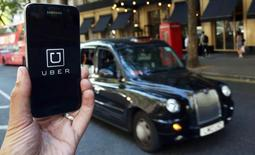 A photo illustration shows the Uber app logo displayed on a mobile telephone, as it is held up for a posed photograph in central London, Britain August 17, 2016.    REUTERS/Neil Hall/Illustration