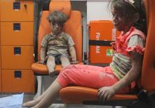 Five-year-old Omran Daqneesh, with bloodied face, sits with his sister inside an ambulance after they were rescued following an airstrike in the rebel-held al-Qaterji neighbourhood of Aleppo, Syria August 17, 2016. Picture taken August 17, 2016. REUTERS/Mahmoud Rslan  EDITORIAL USE ONLY. NO RESALES. NO ARCHIVES     TPX IMAGES OF THE DAY