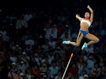 Yelena Isinbayeva of Russia competes during the women's pole vault final of the athletics competition in the National Stadium at the Beijing 2008 Olympic Games August 18, 2008.     REUTERS/Mike Blake