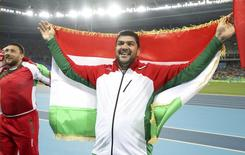 2016 Rio Olympics - Athletics - Final - Men's Hammer Throw Final - Olympic Stadium - Rio de Janeiro, Brazil - 19/08/2016.  Dilshod Nazarov (TJK) of Tajikistan celebrates winning the gold medal.  REUTERS/Phil Noble