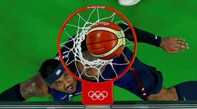 2016 Rio Olympics - Basketball - Semifinal - Men's Semifinal Spain v USA - Carioca Arena 1 - Rio de Janeiro, Brazil - 19/8/2016. Carmelo Anthony (USA) of the USA looks at the ball. REUTERS/Jim Young