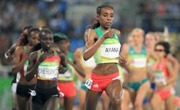 2016 Rio Olympics - Athletics - Final - Women's 5000m Final - Olympic Stadium - Rio de Janeiro, Brazil - 19/08/2016. Almaz Ayana (ETH) of Ethiopia competes  REUTERS/Dominic Ebenbichler