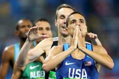 2016 Rio Olympics - Athletics - Final - Men's 1500m Final - Olympic Stadium - Rio de Janeiro, Brazil - 20/08/2016. First placed Matthew Centrowitz (USA) of USA celebrates next to third placed Nicholas Willis (NZL) of New Zealand.  REUTERS/Ivan Alvarado