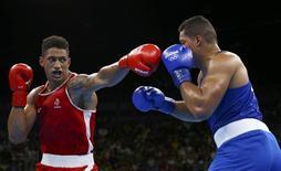 2016 Rio Olympics - Boxing - Final - Men's Super Heavy (+91kg) Final Bout 273 - Riocentro - Pavilion 6 - Rio de Janeiro, Brazil - 21/08/2016. Tony Yoka (FRA) of France and Joseph Joyce (GBR) of Britain compete.   REUTERS/Peter Cziborra