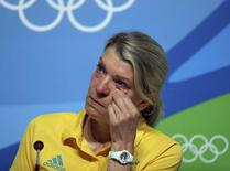 Kitty Chiller, Chef de Mission for Australia at the Rio 2016 Olympic Games, wipes her eyes during a press conference in which she spoke about the fines levied against a group of their athletes for entering the basketball arena without proper accreditation, in Rio de Janeiro August 20, 2016. REUTERS/Chris Helgren