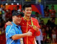 2016 Rio Olympics - Badminton - Men's Singles - Victory Ceremony - Riocentro - Pavilion 4 - Rio de Janeiro, Brazil - 20/08/2016. Gold medallist Chen Long (CHN) of China poses with his coach Li Yongbo. REUTERS/Marcelo del Pozo