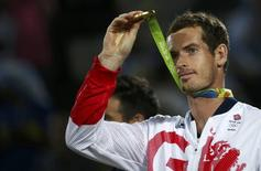 Gold medalist Andy Murray (GBR) of Britain reacts after receiving his medal.  REUTERS/Marcos Brindicci