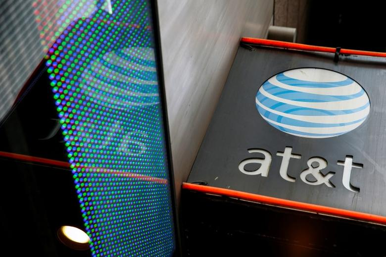 The signage for an AT&T store is seen in New York, October 29, 2014. REUTERS/Shannon Stapleton/File Photo