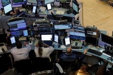 Traders work at desks on the floor of the New York Stock Exchange (NYSE) in New York City, U.S., August 23, 2016.  REUTERS/Brendan McDermid