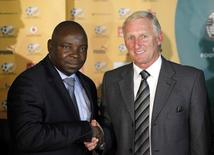Former SAFA (South African football association) president Kirsten Nematandani (L)  with  Gordon Igesund, Johannesburg, June 30, 2012.  REUTERS/Siphiwe Sibeko