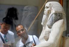 Tourists look at pharaonic artefact inside the Egyptian Museum during the summer season in Cairo, Egypt, July 14, 2016. REUTERS/Mohamed Abd El Ghany