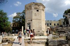 Tourists visit the Tower of the Winds, open to the public for the first time in more than 200 years after being restored, in the Roman Agora, in Plaka, central Athens, Greece, August 23, 2016. Picture taken August 23, 2016.   REUTERS/Michalis Karagiannis