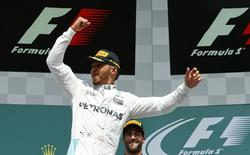 Germany Formula One - F1 - German Grand Prix 2016 - Hockenheimring, Germany - 31/7/16 - Mercedes' Lewis Hamilton celebrates after winning the race. REUTERS/Ralph Orlowski
