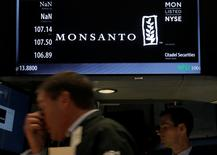 A trader works at the post where Monsanto Co. is traded on the floor of the New York Stock Exchange (NYSE) in New York City, U.S., August 25, 2016. REUTERS/Brendan McDermid
