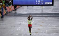 2016 Rio Olympics - Athletics - Final - Men's Marathon - Sambodromo - Rio de Janeiro, Brazil - 21/08/2016. Feyisa Lilesa (ETH) of Ethiopia celebrates as he wins silver      REUTERS/Sergio Moraes