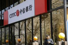 A man stands in front of CITIC bank's branch in Beijing, China, in this March 23, 2016 file photo.   REUTERS/Kim Kyung/File Photo