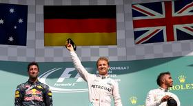 Belgium Formula One - F1 - Belgian Grand Prix 2016 - Francorchamps, Belgium - 28/8/16 - Mercedes' Nico Rosberg of Germany (C) celebrates on the podium with Mercedes' Lewis Hamilton of Britain (R) and Red Bull's Daniel Ricciardo of Australia (L) after the Belgian F1 Grand Prix.  REUTERS/Yves Herman
