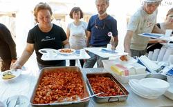 "People stand in line for ""Amatriciana"", a type of pasta dish created in Amatrice, at a tent camp in Sant'Angelo, following an earthquake in central Italy, August 28, 2016. REUTERS/Ciro De Luca"
