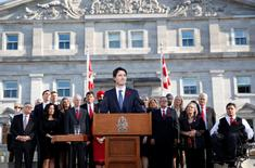 Prime Minister Justin Trudeau speaks to the crowds outside Rideau Hall after the Cabinet's swearing-in ceremony in Ottawa November 4, 2015. REUTERS/Blair Gable/File Photo
