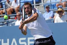 Aug 29, 2016; New York, NY, USA; Marin Cilic of Croatia returns a shot for the win against Roger Dutra Silva of Brazil on day one of the 2016 U.S. Open tennis tournament at USTA Billie Jean King National Tennis Center. Mandatory Credit: Anthony Gruppuso-USA TODAY Sports