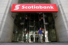 A woman leaves a Bank of Nova Scotia (Scotiabank) branch in Ottawa, Ontario, Canada, May 31, 2016. REUTERS/Chris Wattie