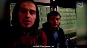 Кадр из видео, опубликованного в социальных сетях, на котором видны Усман Мурдалов и Сулим Исраилов, совершившие нападение на пост ДПС под Москвой. Видео опубликовано 18 августа 2016 года. REUTERS TV