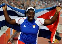 Yarelys Barrios of Cuba celebrates after finishing second in the women's discus throw athletics final at the National Stadium during the Beijing 2008 Olympic Games, August 18, 2008.     REUTERS/Wolfgang Rattay