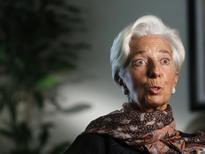 Selon Christine Lagarde, le Fonds monétaire international va probablement abaisser à nouveau sa prévision de croissance mondiale pour 2016 en raison de la faiblesse de la demande, d'un ralentissement des échanges et des investissements et du creusement des inégalités. L'institution a déjà abaissé en juillet sa prévision de croissance du PIB mondial à 3,1% pour cette année et à 3,4% pour 2017. /Photo prise le 31 août 2016/REUTERS/Gary Cameron