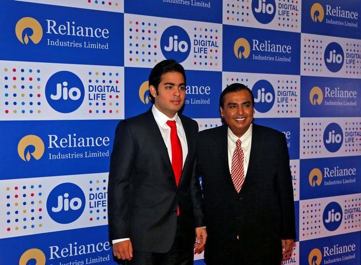 Mukesh Ambani (R), chairman of Reliance Industries Ltd, poses with his son Akash before addressing the company's annual general meeting in Mumbai, India September 1, 2016. REUTERS/Shailesh Andrade