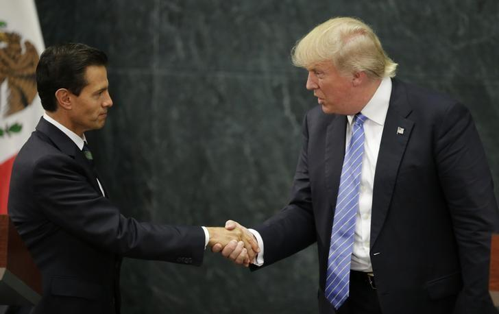 U.S. Republican presidential nominee Donald Trump and Mexico's President Enrique Pena Nieto shake hands at a press conference at the Los Pinos residence in Mexico City, Mexico, August 31, 2016. REUTERS/Henry Romero
