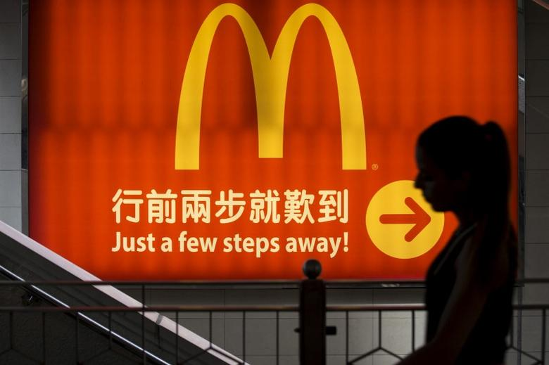 A woman walks past a McDonald's outlet in Hong Kong in this July 25, 2014 file photo.  REUTERS/Tyrone Siu/File Photo
