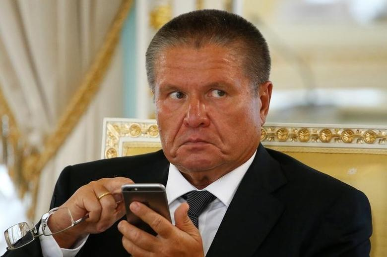 Russian Economy Minister Alexei Ulyukayev uses his mobile phone before a meeting of Russian President Vladimir Putin and Turkish President Tayyip Erdogan with Russian and Turkish entrepreneurs at the Konstantinovsky Palace in St. Petersburg, Russia, August 9, 2016.  REUTERS/Sergei Karpukhin