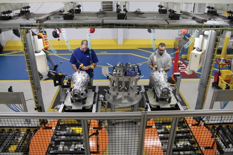 Employees work on the eight-speed transmission at the FCA US LLC Kokomo Transmission Plant in Kokomo, Indiana on March 17, 2014.  REUTERS/Fiat Chrysler/Handout via Reuters