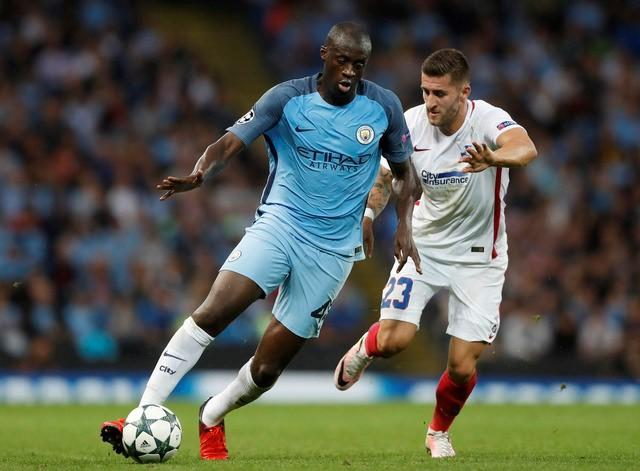 Manchester City's Yaya Toure in action with Steaua Bucharest's Ovidiu Popescu Action Images via Reuters / Carl RecineLivepic