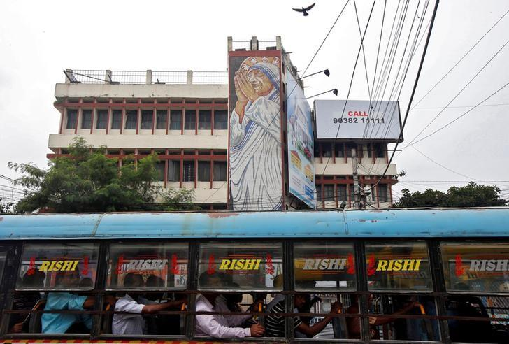 A passenger bus moves past an image of Mother Teresa installed alongside a road ahead of her canonisation ceremony, in Kolkata, India, September 2, 2016. REUTERS/Rupak De Chowdhuri