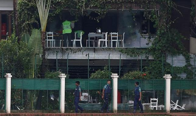 Policemen patrol outside the Holey Artisan Bakery and the O'Kitchen Restaurant as others inspect the site after gunmen attacked, in Dhaka, Bangladesh, July 3, 2016. REUTERS/Adnan Abidi/File photo