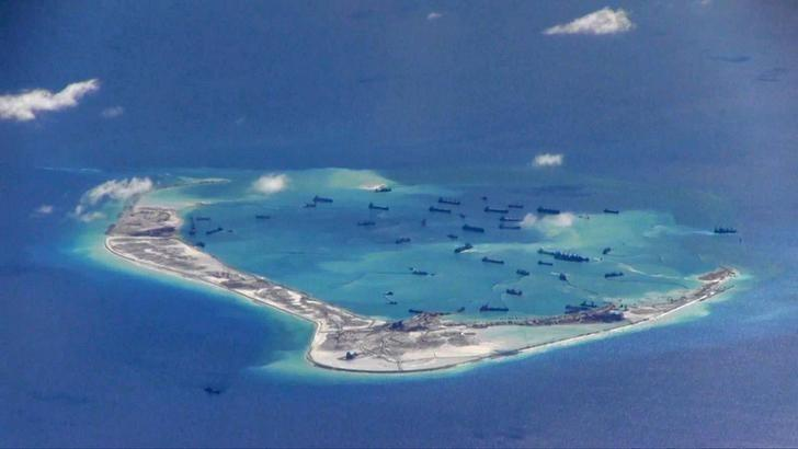 FILE PHOTO: Chinese dredging vessels are purportedly seen in the waters around Mischief Reef in the disputed Spratly Islands in the South China Sea in this still image from video taken by a P-8A Poseidon surveillance aircraft provided by the United States Navy May 21, 2015.  U.S. Navy/Handout via Reuters/File Photo