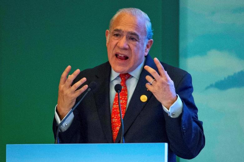 Angel Gurria, Secretary-General of OECD speaks on stage at the High-level Tax Symposium held in Chengdu, China, July 23, 2016. REUTERS/Ng Han Guan/Pool/File Photo - RTSJDA9